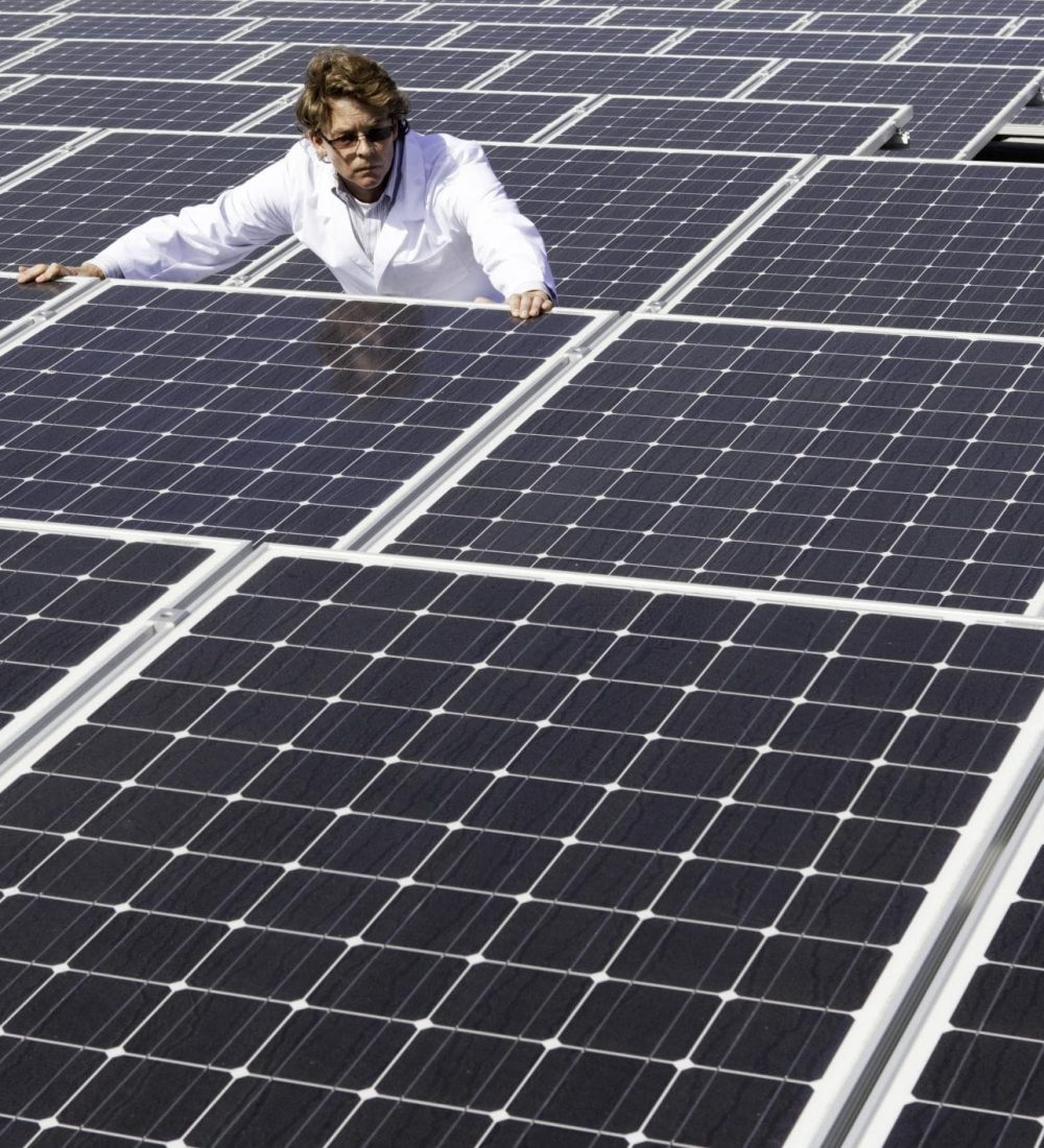 man in the middle of solar panels