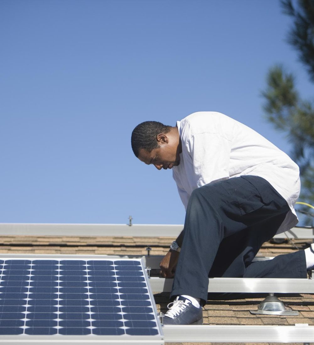 man on the roof installing solar panels